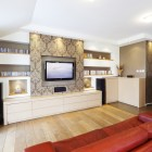 Wraparound cabinets and red sofa