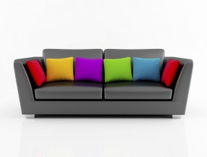 Leather sofa with rainbow of pillows