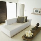 Living room with white chaise lounge