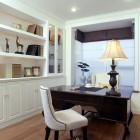 Dark wood desk in white study