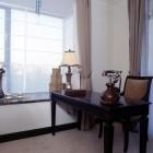 Dark wood desk by window