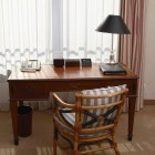 Wood desk by a bright window