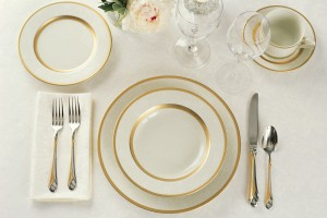 White and gold dish place-setting