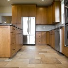 Kitchen in newly constructed house with tile floor