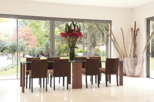 Large open plan dining room with reflective white floor