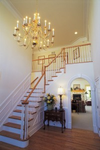 Foyer with staircase and chandelier