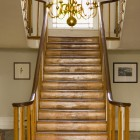 Original wood stairs leading up two lights