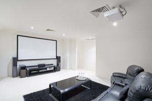 Home Theater Room with black leather recliner chairs