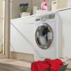 Compact and useful laundry room with a window