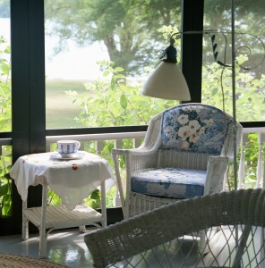 Wicker furniture in green sunroom